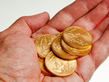 Gold coins in your hand.